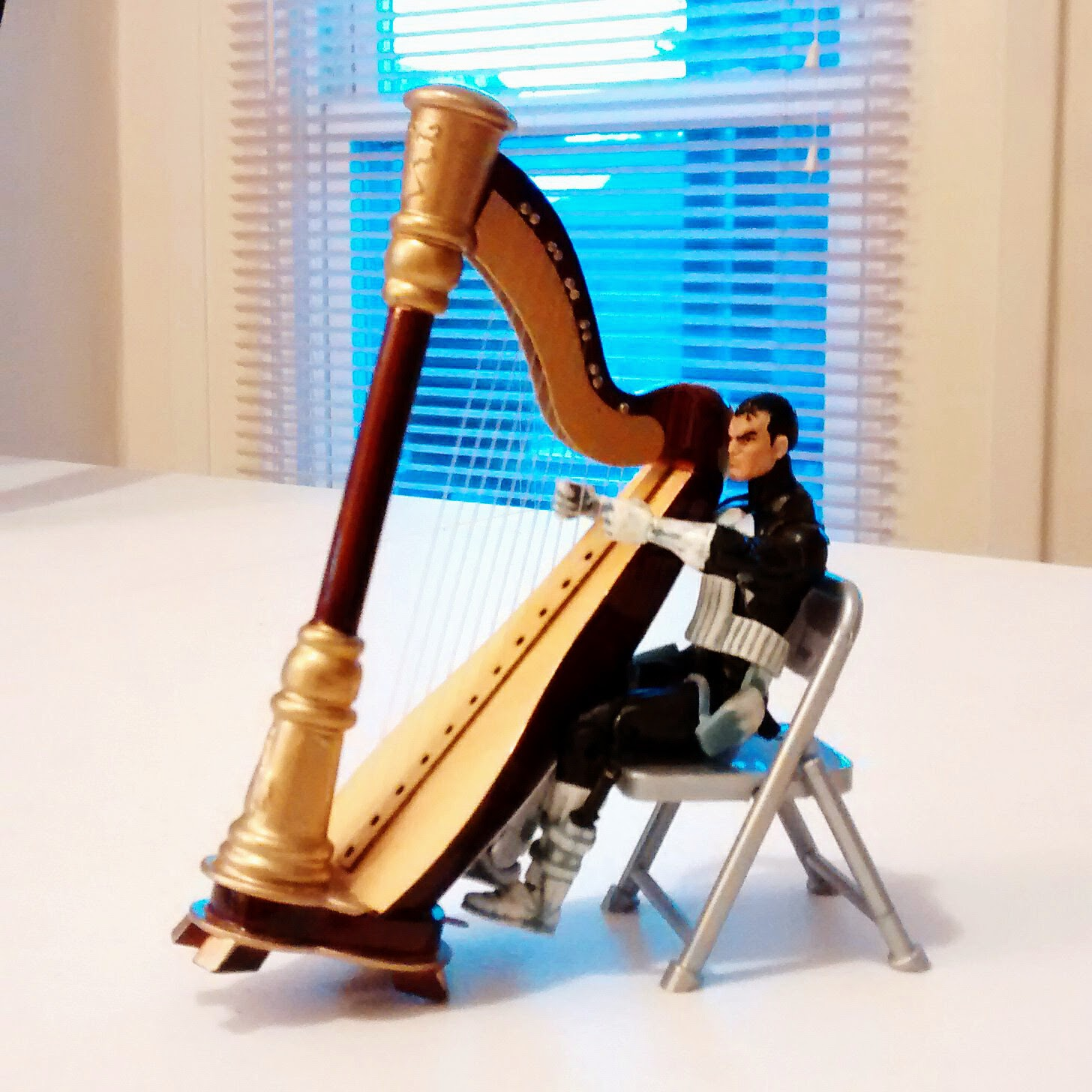 Yes, he can sit and play his harp after all!