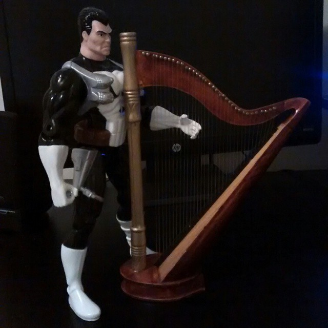 Frank poses with his harp.