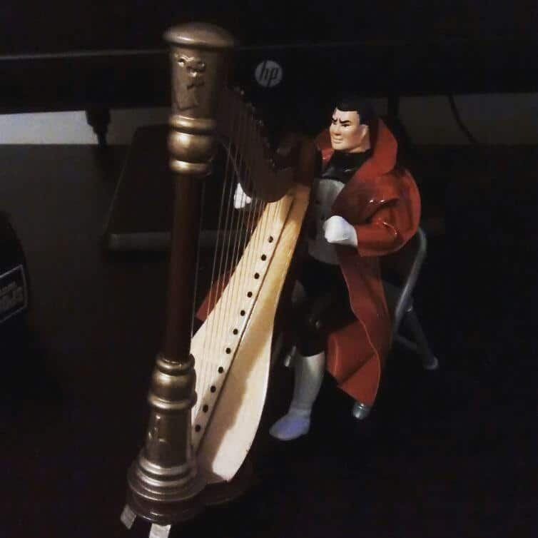 Punisher enjoying his harp.