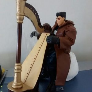 Avenging Angel Punisher adjusting to his new harp.