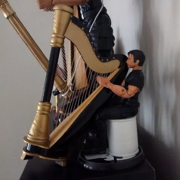 Thomas Jane relaxing by his harp.