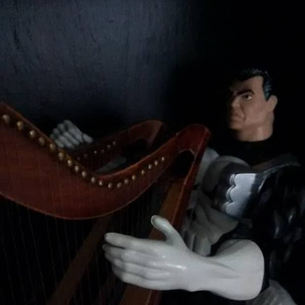 A dark scene with two harps played together by one Punisher.