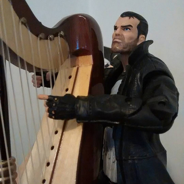 Punisher gazing up to the Heaven's again as he plays his harp.