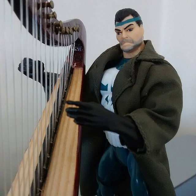 Animated Series Punisher practices some harp gestures.
