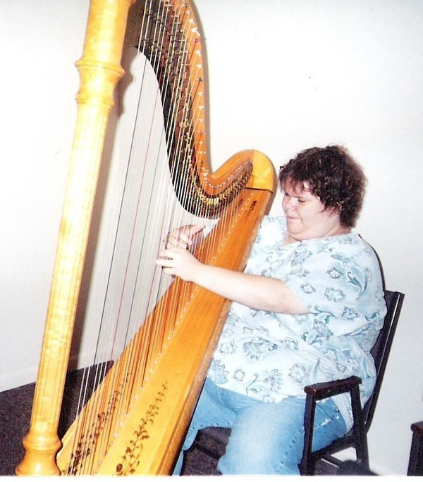 Me when I played and rented the Lyon & Healy style 15 I rented from Michigan Harp Center.