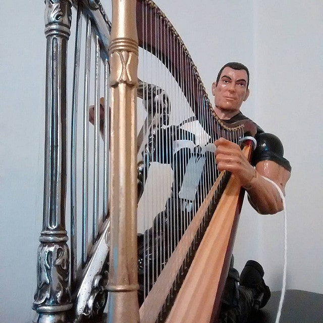 Punisher doing a double harp performance.