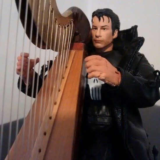Thomas Jane as The Punisher on his harp.