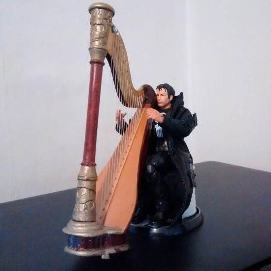 Thomas Jane as The Punisher practicing his harp.