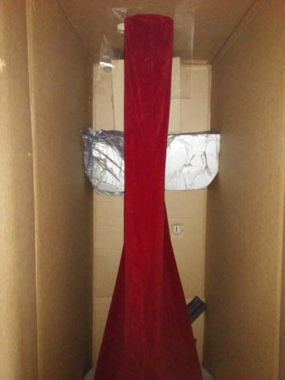 Grover, the harp, is inside the box underneath the red cover.