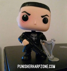 He's trying out on a small harp he borrowed from a small Punisher figure. Soon I'll have to get for him a harp of his own.