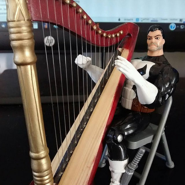 Frank Castle, The Punisher, plays on a smaller harp.