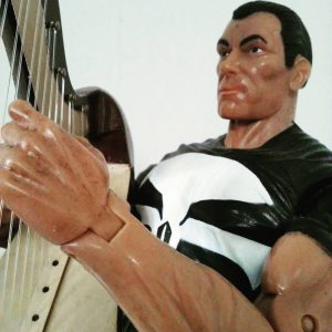 Punisher and his harp playing.