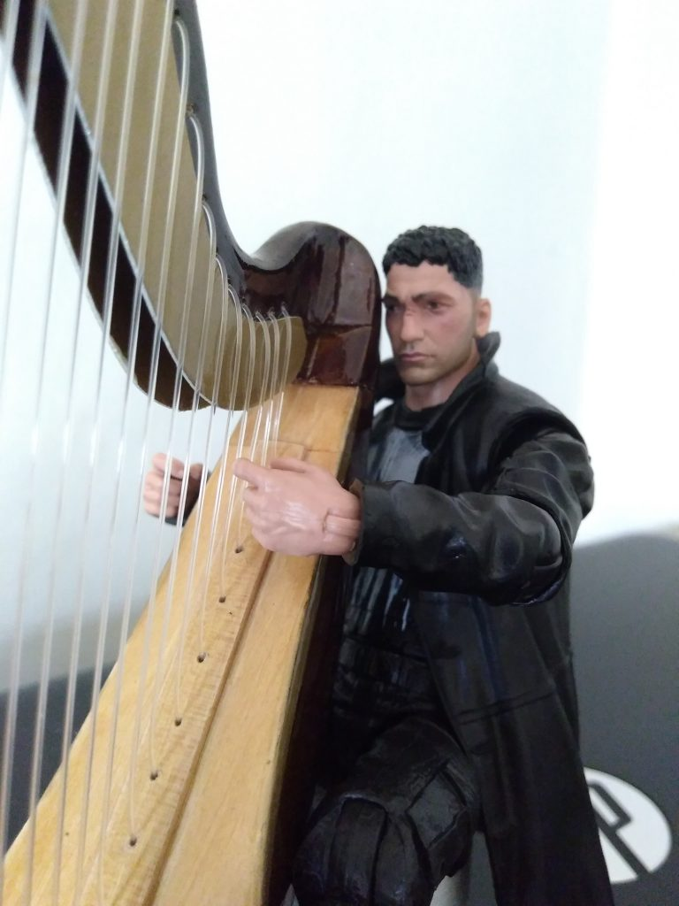 A close up of Frank and his harp.
