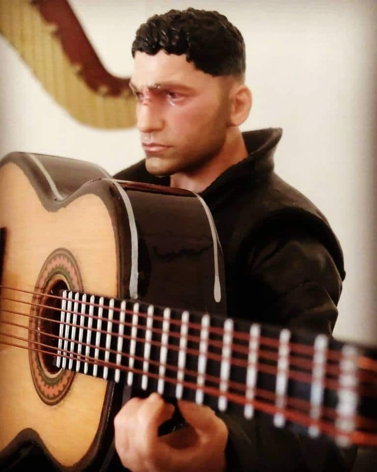 He's going to be in a prison uniform when he does his guitar performance on Netflix's The Punisher.