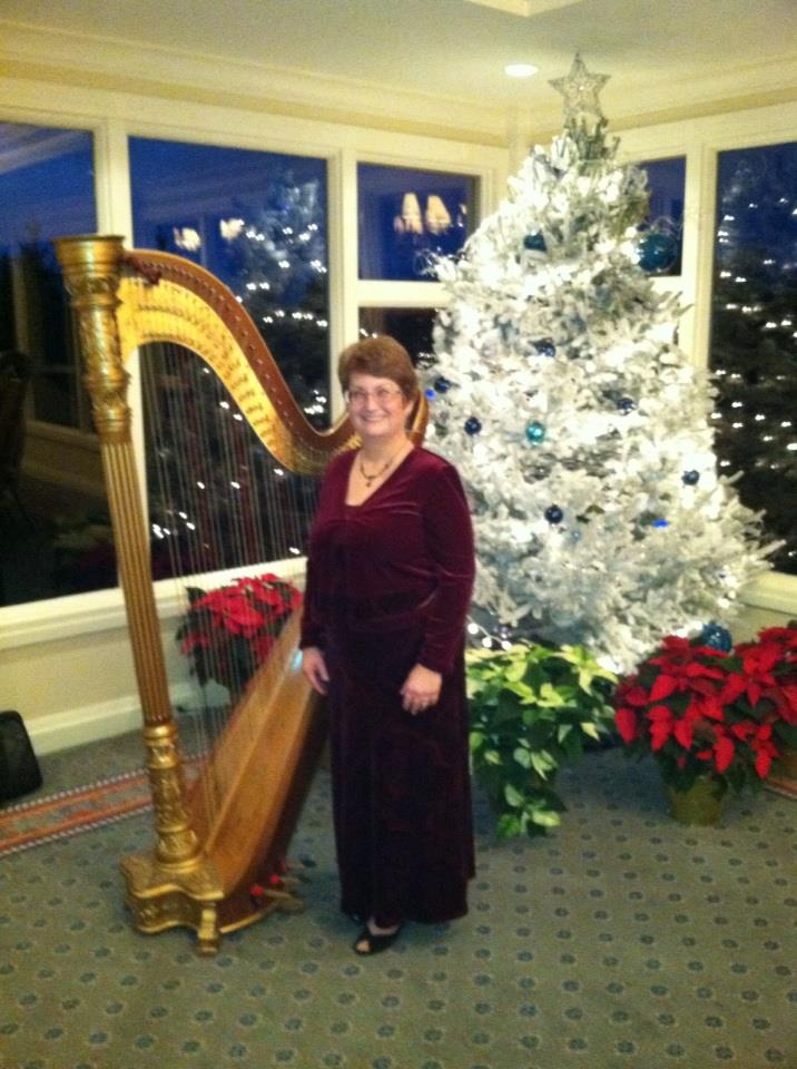 "My harp teacher, Ellen Grafius and her harp ""Nutkin"" a L&H Style 17 semi-concert grand pedal harp. She named her harp after Squirrel Nutkin from classic Beatrix Potter stories."