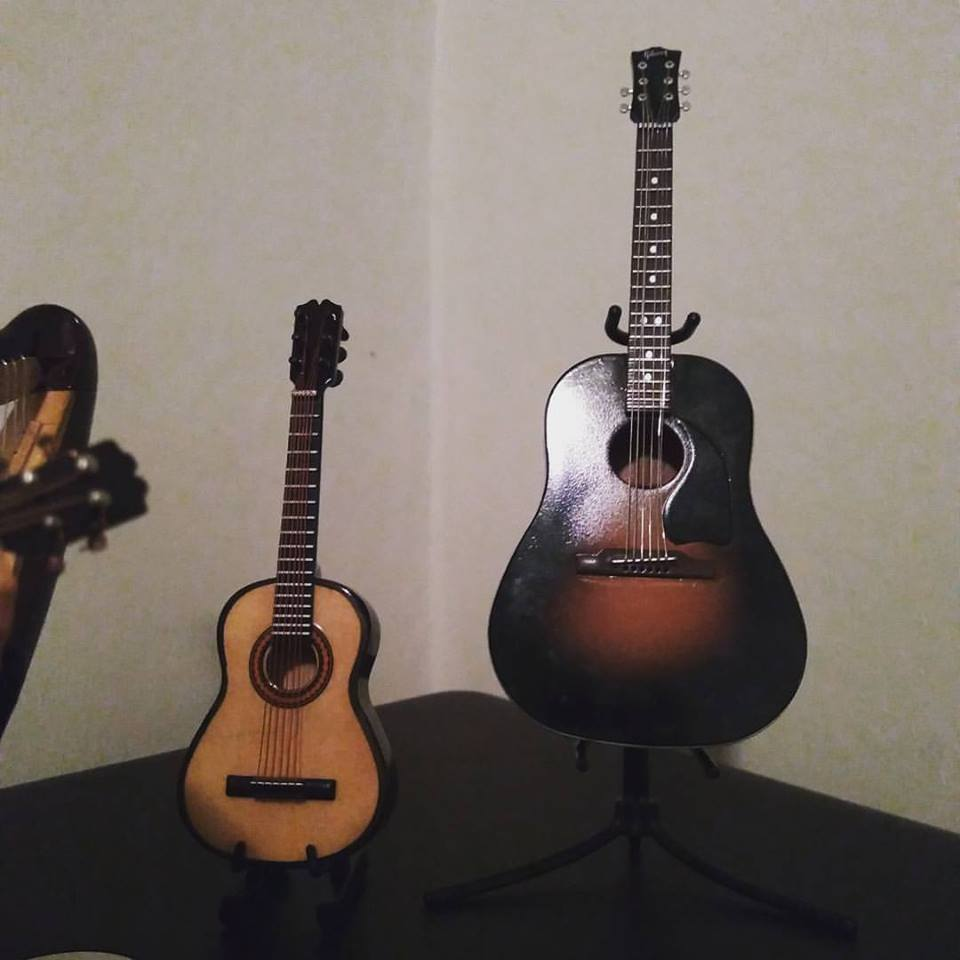 Two guitars. The guitar on the right which replicates Punisher's actual guitar.